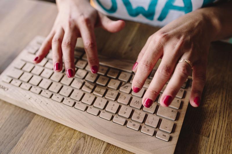Woman typing on wireless keyboard