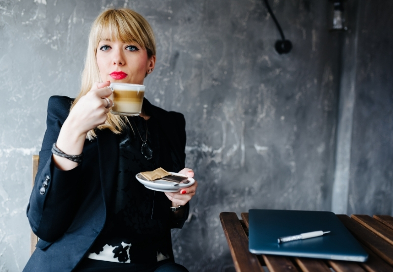 Woman having coffee in the office